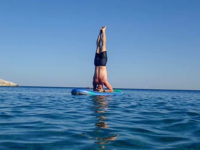 Yoga Sea Water Sky Lifestyles Real People Leisure Activity One Person Blue Vacations Trip Beauty In Nature Holiday Outdoors Horizon Over Water