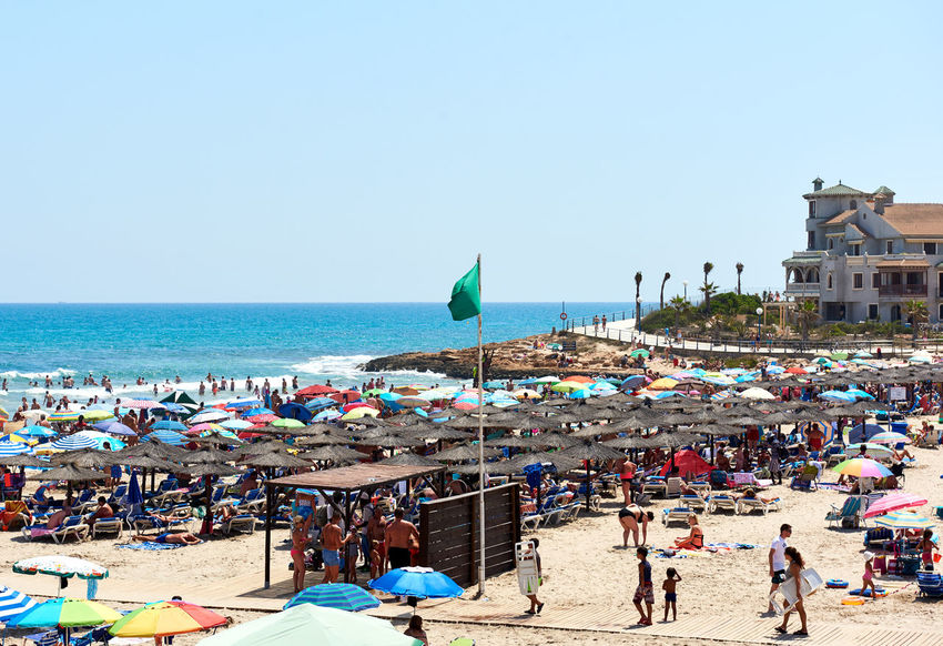 Orihuela, Spain - August 17, 2017: People enjoying the summer on the beach of La Zenia, Orihuela coast. Costa Blanca. Spain Alicante Province Spain Mediterranean Sea Orihuela  SPAIN Summer Collection Summertime Torrevieja Beach Beauty In Nature Clear Sky Coast Crowd Of People Horizon Over Water Large Group Of People Nature Outdoors People Real People Sea Sky Summer Tourist Resort Travel Destinations Vacations Water