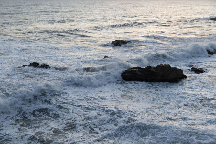 Sunrise of Naksansa, Yangyang, Gangwondo, South Korea Beach Beauty In Nature Crash Day Force Motion Naksansa Nature No People Outdoors Power In Nature Rock - Object Sea Sunrise Surf Water Wave