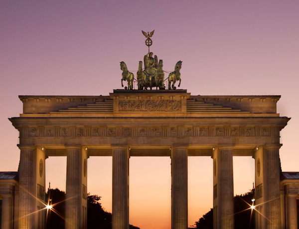Brandenburger Gate in Berlin, Germany against clear sky Berlin Berlin Mitte Brandenburg Gate Sightseeing Animal Representation Architectural Column Architecture Art And Craft Brandenburger Tor Building Exterior Built Structure City City Gate Clear Sky Gate Germany History Illuminated Low Angle View Monument Night No People Outdoors Pariser Platz Sculpture Sky Statue Tourism Travel Travel Destination Travel Destinations Triumphal Arch Urban Icon