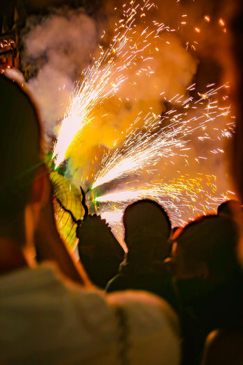 Celebration Fireworks Sparkling Backgrounds Burning Celebration Celebration Event Ceremony Close-up Costume Exploding Exploding Fireworks Explotion  Fire Heat - Temperature Human Hand Long Exposure Men Motion Night Nightlife One Person Outdoors People Real People