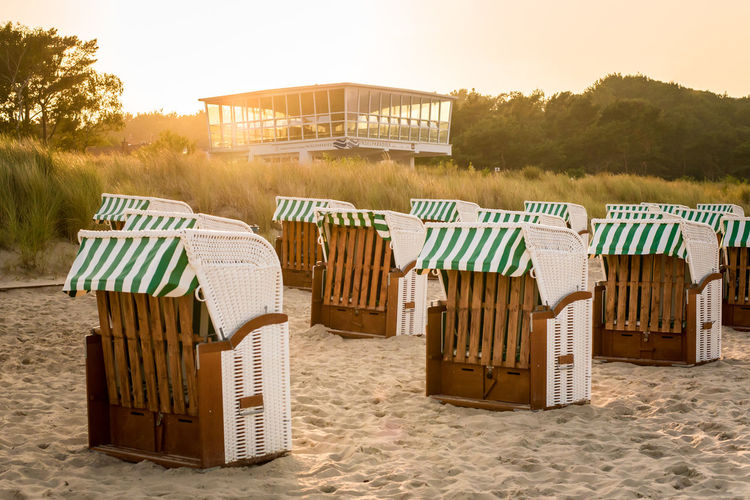 Summer Holidays Sunset_collection Absence Baabe Beach Beach Chairs Chair Day Green Color Holiday Hooded Beach Chair Land Nature No People Outdoor Chair Outdoors Relaxation Ruegen Sand Seat Sky Striped Sunset Tranquility Trip Vacations Autumn Mood Capture Tomorrow 2018 In One Photograph