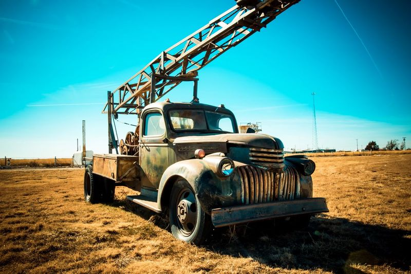 Field Transportation Blue Land Vehicle Mode Of Transport Sky Day Agricultural Machinery Outdoors Landscape No People Machinery Sunlight Clear Sky Agriculture Rural Scene Nature