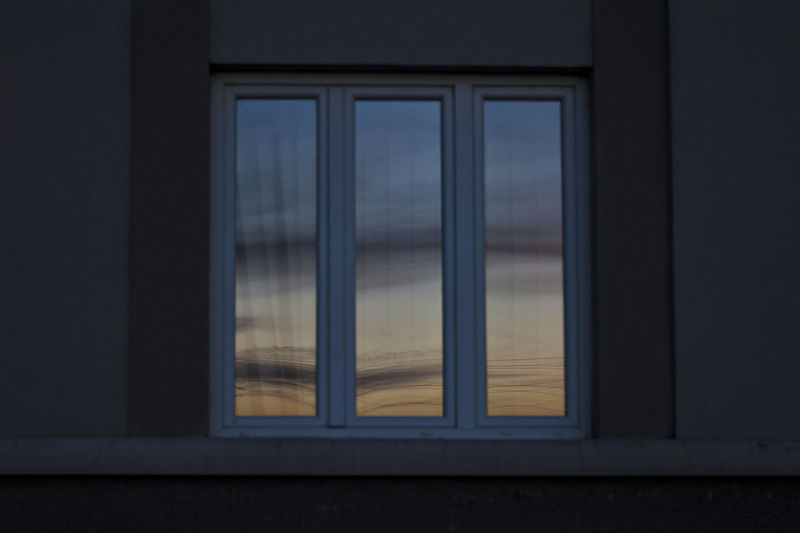 Reflection of sky seen through glass window