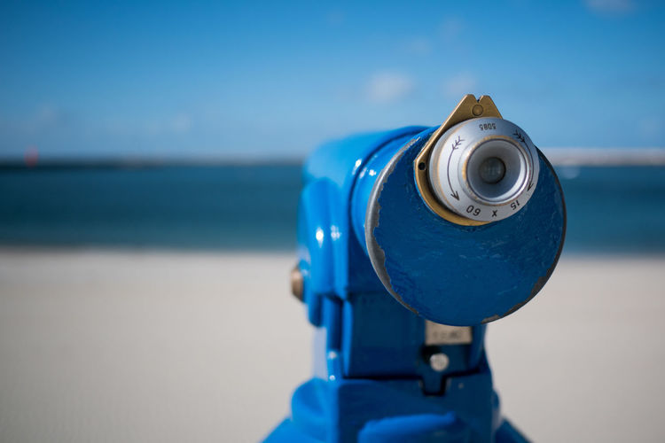 Close-Up Of Coin-Operated Binoculars Against Blurred Background