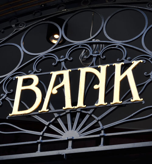 Bank building with bank letters or entrance sign of wrought iron. Banks Financial District  Iron Letters Sign Signs Bank Bank Account Bank Building Banking Building Building Exterior Buildings Communication Design Finance Finance And Economy Metal No People Ornate Pattern Symbol Text Western Script Wrought Iron
