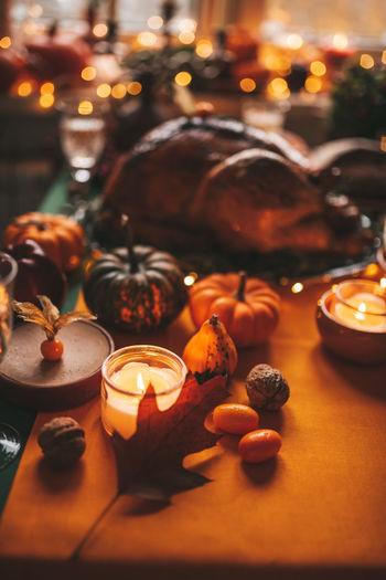 Close-up of illuminated pumpkin on table