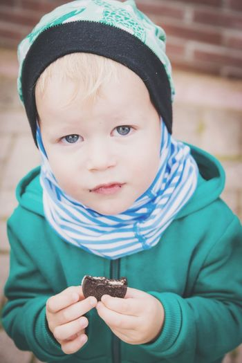 Close-Up Portrait Of Boy Holding Cookie