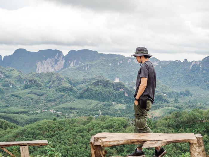 Solo traveller enjoying beautiful nature of hills and during rainy season