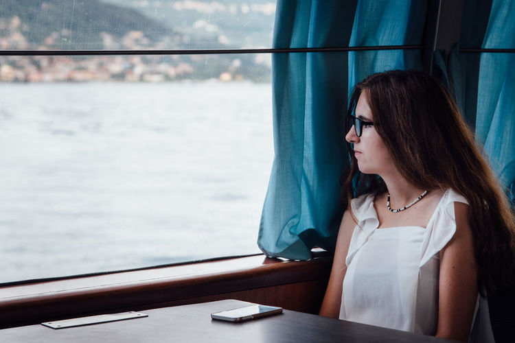 EyeEm Selects Water Only Women One Person One Woman Only Adult One Young Woman Only People Adults Only Day Young Adult Women Sitting Young Women Leisure Activity Outdoors Nature Sky Ferry Ferryboat Romantic Melancholic Teenager Girl Life