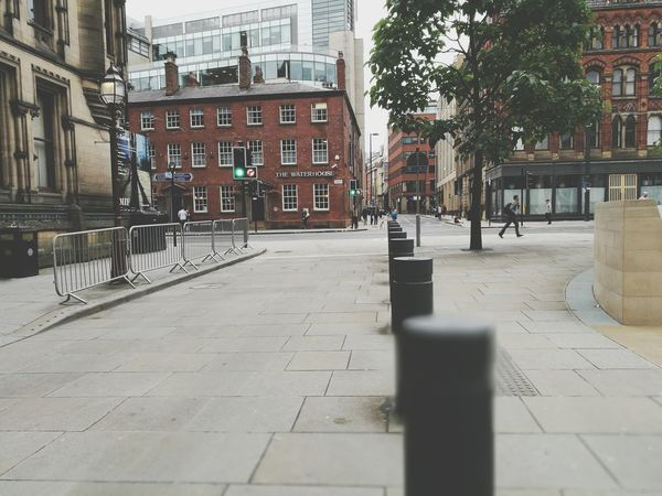 Glorious Manchester.... ArchitectureEyeEm Selects Built Structure Building Exterior Outdoors Day City Sky Street City Centre Tram City Life Buildings Cityscape Bollards