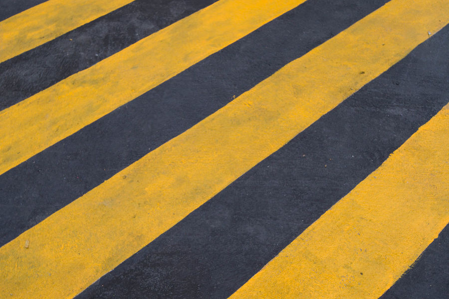 The area is painted yellow and black to beware slipping.