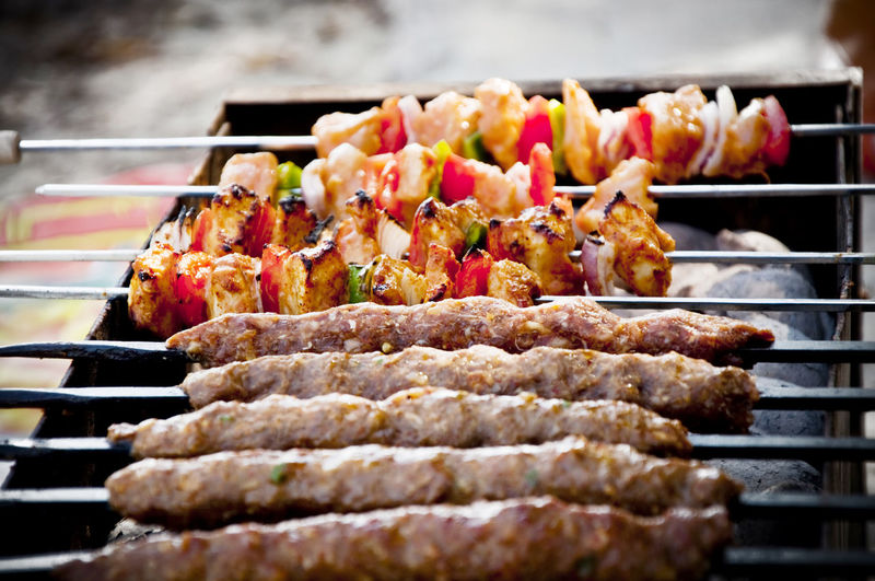 Close-up of kebabs on barbecue grill