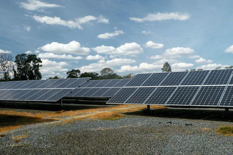 Solar panels on ground against sky