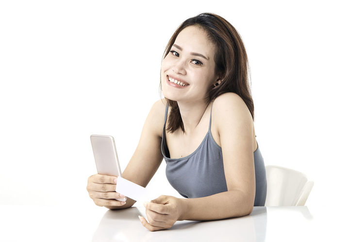 Thai Studio Shot 30-34 Years Shopping Online  Young Female Happy Asian  Laptop Beautiful Internet Attractive Smile person Computer People Portrait Holding Phone Beauty Mobile Pretty Technology Payment Adult Using Lifestyle Cheerful Purchase Business Wireless Lady Chinese Fashion Looking Smartphone Japanese  Korean Credit Card Empty Text Copy Space Communication Smiling White Background Young Adult Wireless Technology Connection One Person Indoors  Front View Young Women Mobile Phone Happiness Teeth Cut Out Toothy Smile Women Beautiful Woman