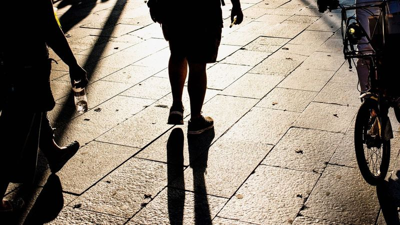 Low Section Walking Shadow Sunlight Human Leg City Street Unrecognizable Person Human Limb Transportation Lifestyles Body Part High Angle View Nature Road Real People Day Footpath Limb Human Body Part