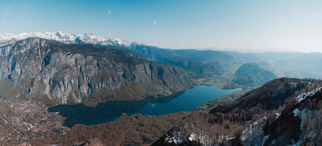 Lake Bohinj in its entirety. Lake Bohinj Slovenia Bohinj, Slovenia Mountain Beauty In Nature Scenics - Nature Landscape Environment Snow Cold Temperature Sky Winter Mountain Range Nature Tree Pinaceae Pine Tree Tranquility Non-urban Scene Tranquil Scene No People Travel Destinations Coniferous Tree The Traveler - 2018 EyeEm Awards