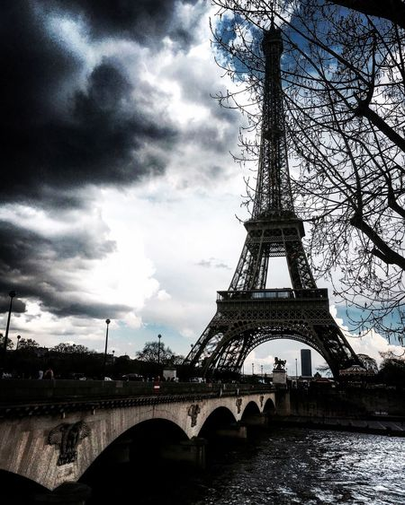 Eiffel Tower Monument Paris Backlight Shittyweather Sunshine Clouds Rain Dark Bridge Seine Water Tree Light And Shadow Cityscape Streetphotography Mmaff From My Point Of View Eye4photography  EyeEm Gallery Taking Photos Hello World