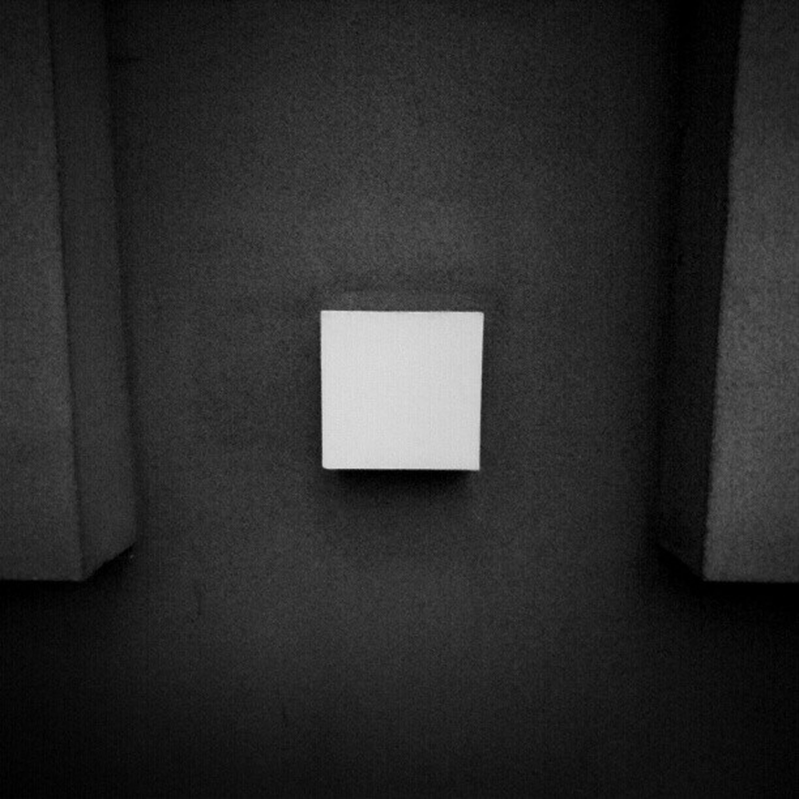 indoors, wall - building feature, copy space, wall, home interior, close-up, white color, architecture, no people, built structure, white, dark, window, shadow, electricity, simplicity, domestic room, pattern, illuminated, darkroom