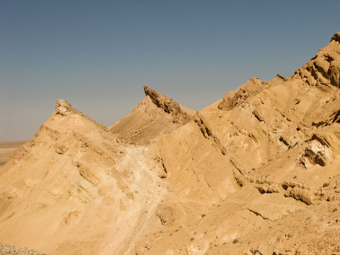 Low angle view of desert against sky