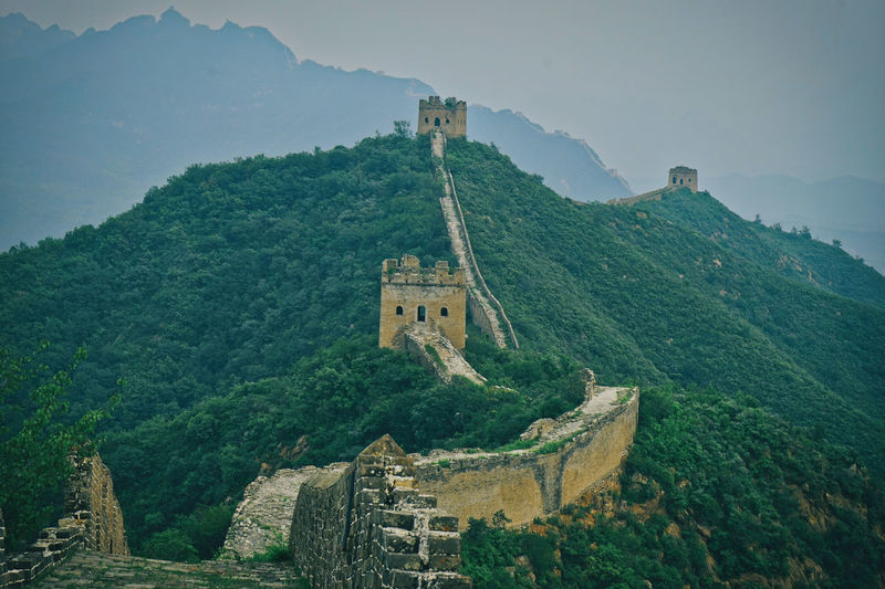 Castle on mountain against sky