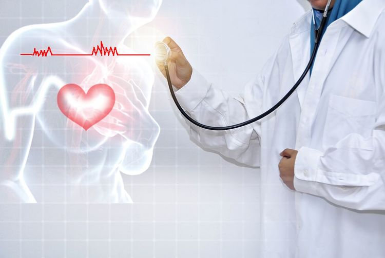 Digital composite image of doctor examining pulse rate