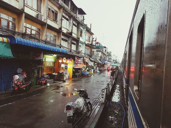 Train in the the way to SamutSakhon Sad Faith Traffic Jam Light And Shadow Life Waiting Cold Temperature Outdoors Rain RainDrop Train Train Station City Architecture Sky Building Exterior Built Structure City Street Old Town Street Street Scene TOWNSCAPE