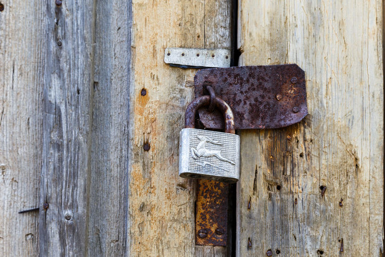 Backgrounds Close-up Closed Day Deterioration Door Entrance Full Frame Latch Lock Metal Nail No People Old Padlock Protection Rusty Safety Security Textured  Weathered Wood - Material