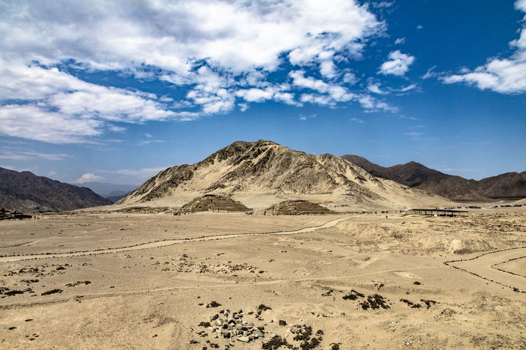Scenic view of arid landscape against sky in caral