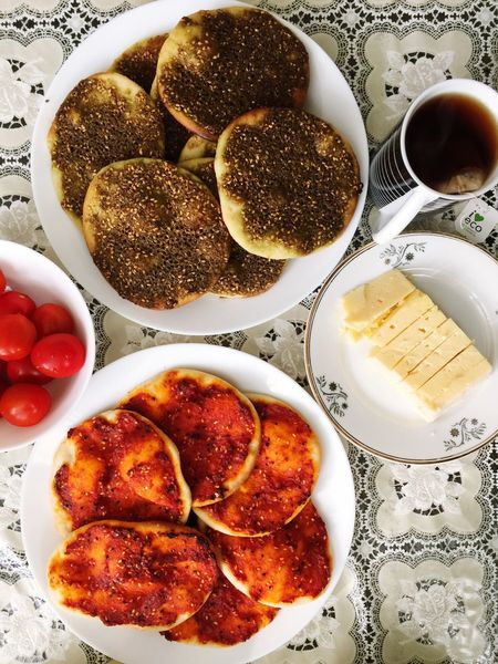 Food And Drink Food Freshness Oriental Bowl Ready-to-eat High Angle View Plate Healthy Eating Close-up Meal Directly Above Table Refreshment Indulgence Pie Muhammara Tomato Beverage Appetizer Temptation Tea Cheese Zaatar Manakish