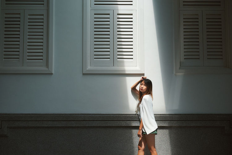 One Person Standing Young Adult Window Young Women Adult Lifestyles Women Indoors  Architecture Real People Looking Hairstyle Long Hair Three Quarter Length Hair Leisure Activity Casual Clothing Day Contemplation Beautiful Woman