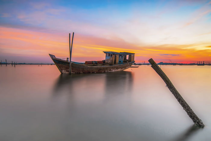 Traditional Boat in sunset Traditional Boat Boat Boats Boats⛵️ Boats And Water Sea Sky Skyscraper Sky And Clouds Batam Batam-Indonesia Landscape Landscape_Collection Landscape_photography Landscapes Beach Beach Photography Batam