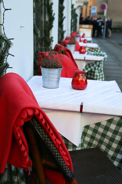Chair Christmas Red Blanket Blankets Chair Close-up Day Freshness Indoors  Nature No People Outdoors Red Red Color Restaurant Street Table Tablecloth Tables