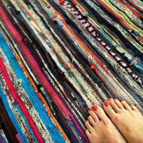 Low section of woman on colorful carpet