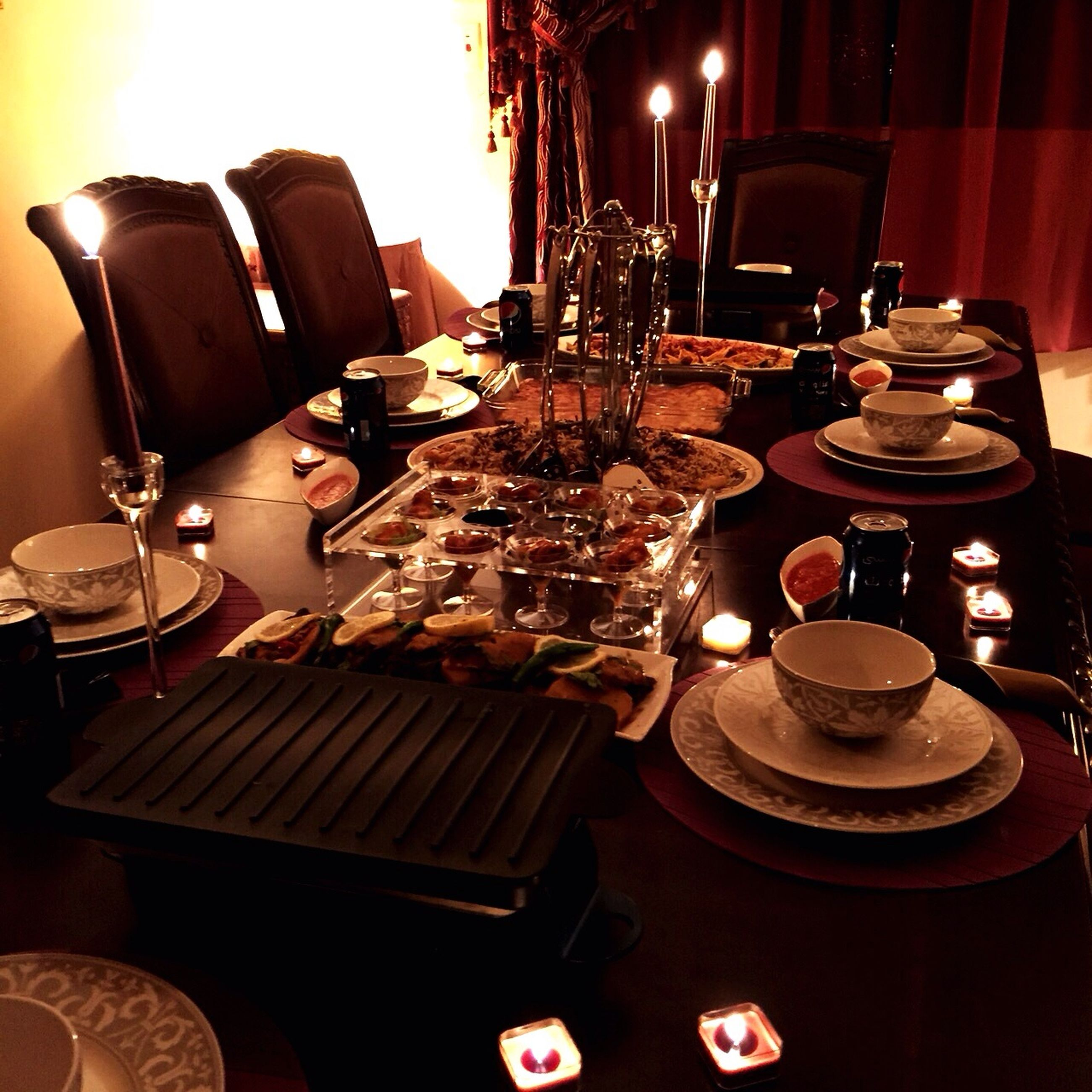 indoors, table, still life, technology, close-up, illuminated, home interior, no people, old-fashioned, focus on foreground, lighting equipment, candle, electricity, retro styled, antique, electric lamp, large group of objects, high angle view, food and drink, music