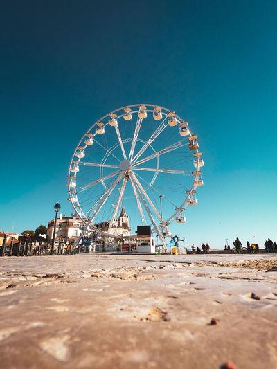 Ferris wheel against clear blue sky