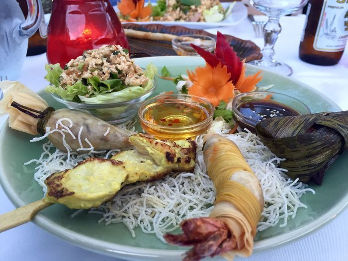 High Angle View Of Various Thai Food Served On Plate In Restaurant