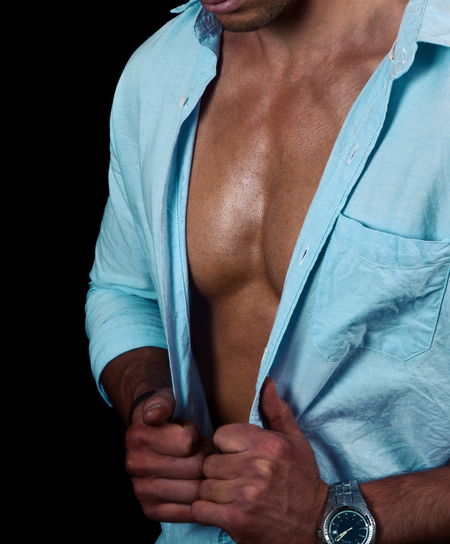 Midsection of man standing against black background