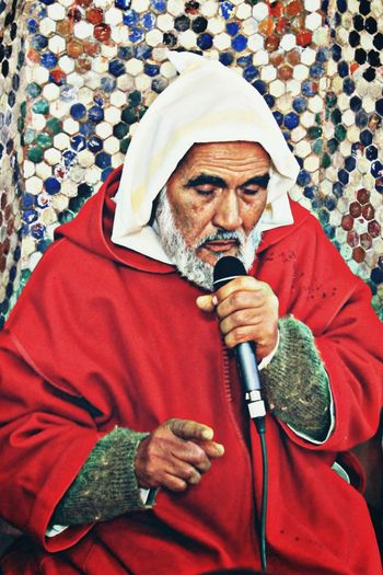 Senior man talking on microphone