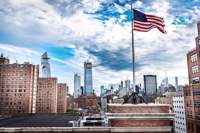 Freedom New York NYC Architecture Built Structure Building Exterior Sky City Flag Cloud - Sky Building Office Building Exterior Patriotism Nature Day Skyscraper Tall - High Tower No People Travel Destinations Travel Modern Outdoors