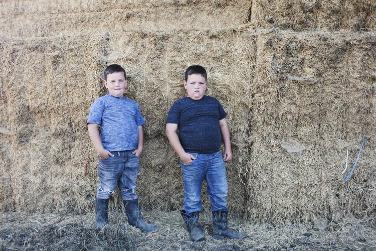 Full length portrait of boys standing outdoors