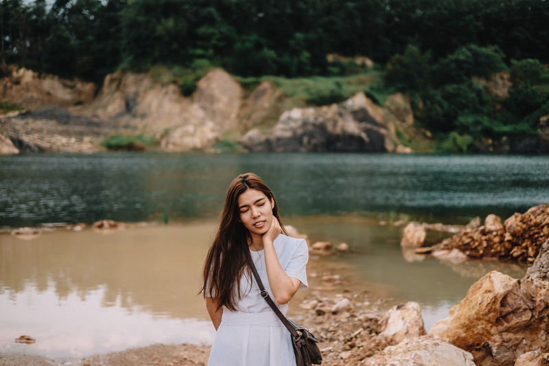 Beautiful Woman Beauty In Nature Casual Clothing Day Focus On Foreground Hair Hairstyle Leisure Activity Lifestyles Long Hair Nature One Person Outdoors Portrait Real People Standing Water Women Young Adult Young Women
