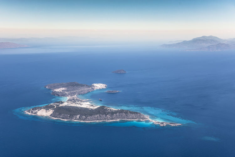 Aerial view of sea and island against sky
