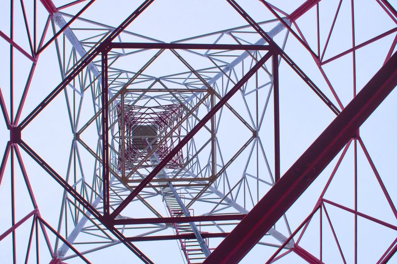 Technology Perspective Daylight Tower Tower Bridge  Telecommunications Equipment Architecture Built Structure Business Finance And Industry Metal Connection Steel Girder Communication Complexity Construction Frame Industry Pattern Electricity Pylon Silhouette Sky Symmetry No People Clear Sky Concentric Day Low Angle View Electricity  Global Communications Outdoors