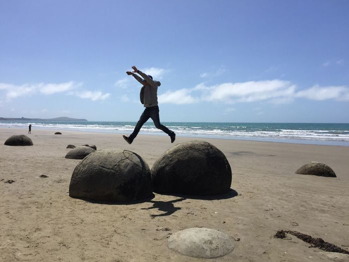 Moeracki bolders / New Zealand Beach Sea Sand Shore Sky Full Length Horizon Over Water Lifestyles Outdoors Cloud - Sky One Person Real People Men Energetic Water Mid-air Day Nature Skill  Leisure Activity EyeEmNewHere Love Yourself
