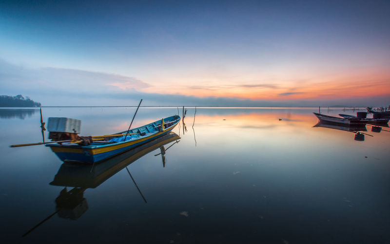 the boat at lake Nautical Vessel Mode Of Transportation Transportation Water Sky Sunset Scenics - Nature Tranquility Reflection Sea Moored Tranquil Scene Beauty In Nature Cloud - Sky Orange Color No People Nature Waterfront Idyllic Outdoors Fishing Boat