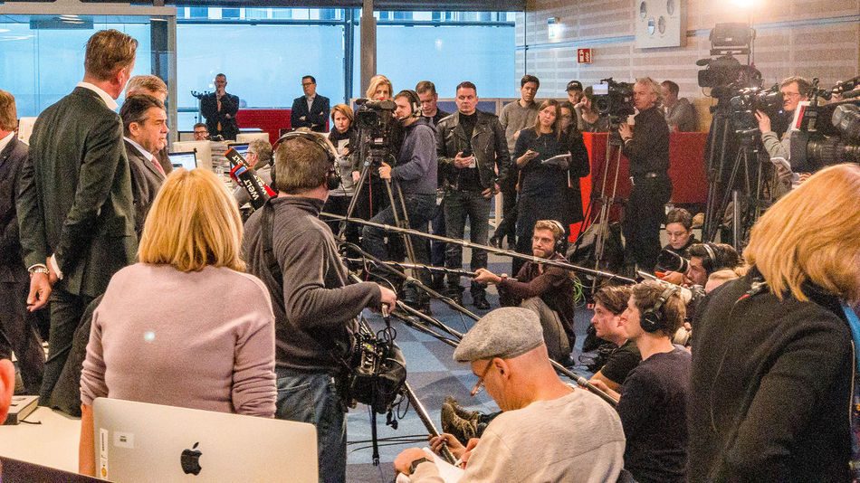 Deniz Yücel is free. Sigmar Gabriel during a press conference in the WELT newsroom in the Axel-Springer-Hochaus, Berlin. Axel-Springer-Hochhaus Sigmar Gabriel Adult Adults Only Arts Culture And Entertainment Audience Crowd Day Deniz Yücel Indoors  Large Group Of People Men People Performance Press Conference Real People Women