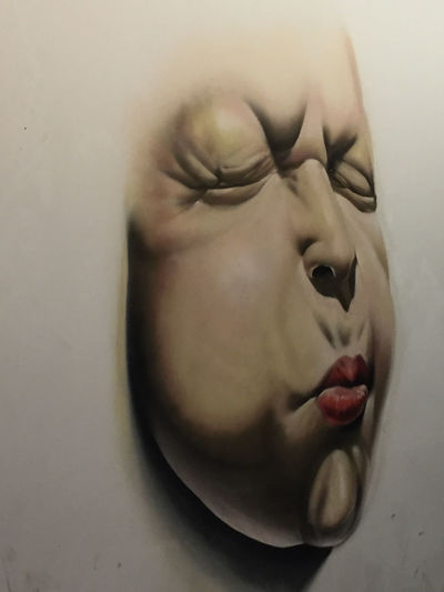 Artistic Drawing Face On A Wall No People Puckered Brows Puckered Lips Street Photography Wall Painting