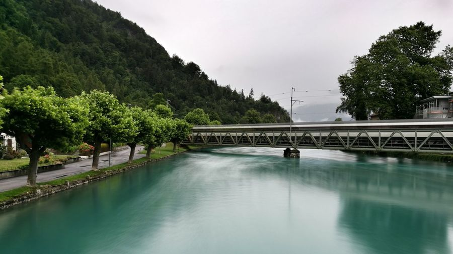 Go With The Flow Water Travel Destinations Landscape Bernese Oberland Eye4photography  Interlaken Switzerland Means Of Transportation Riverview Flowing Water Flowing River Moving Train Tranquility Morning Glory Commute