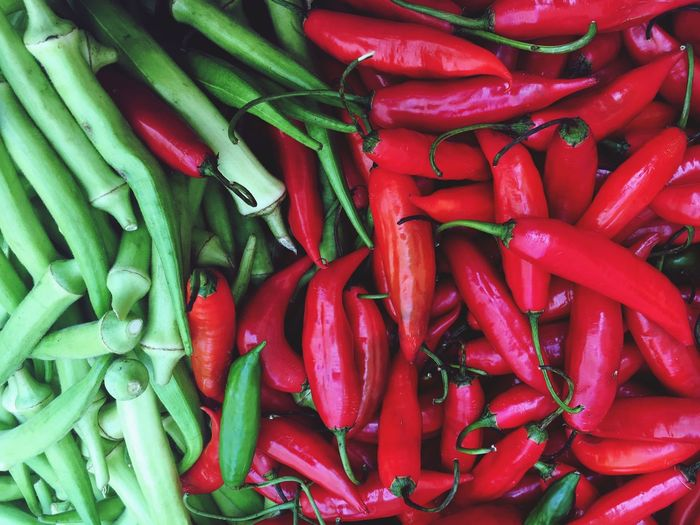 Beautifully Organized Freshness Full Frame Vegetable Food Food And Drink Chili Pepper Red Backgrounds Red Chili Pepper For Sale Healthy Eating No People Retail  Large Group Of Objects Market Green Color Green Chili Pepper Market Stall Close-up okra
